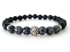 Very cool men's beaded stretch bracelet with 8mm black matte agate beads, 8mm snowflake obsidian beads and pewter accent beads. The patterns and veining in both the agate and obsidian beads is quite stunning and helps create a unique feel to this masculine bracelet. This is a must have bracelet for any guy that loves to wear jewelry!