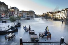 "For the first time in over 20 years, it's been so cold in the Netherlands (and for so long) that the ice on the canals has frozen over. In Leiden, some bars have used this new ""space"" for a winter terrace."