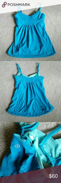 NEW! Lululemon Tank w/ Built-in Bra Sz 4 NEW ARRIVAL THIS WEEK! Lululemon athletica tank w/ built in bra,  size 4. It's a gorgeous electric blue color. Has inserts for pads ( not included ). Bottom is loose but has a continuous drawstring that can be cinched tighter if you prefer. It's been worn but generally good condition. Adjustable straps,  very comfy! lululemon athletica Tops Tank Tops