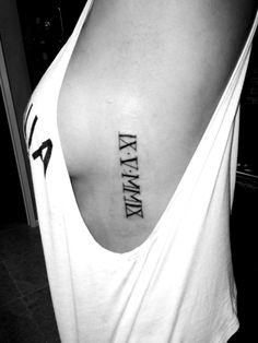 Side anniversary tattoo in Roman numerals. Love the placement