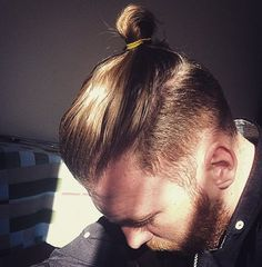 man bun beard undercut hairstyle