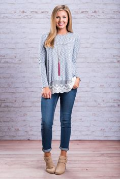 This sky blue top is so wonderful!! We love all the detailing on this casual little top! The lace trim is by far our favorite part! But the buttons that lead to the split in the back is definitely a close second! Pair this fab top with dark wash jeans or white skinnies!