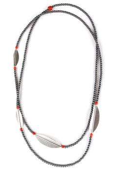 Necklace NIO. A handcrafted long necklace by The Jewelry Story. Made of silver leaf ornaments, hematite and red coral. 110 cm. long Atelier Jan Kerkstra and Marion Pannekoek