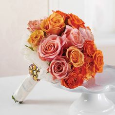 Pink and Orange bridal bouquet with fun brooch