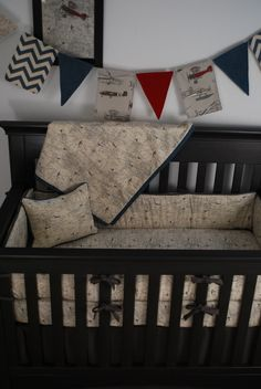 World Map print fabric crib bedding with vintage airplanes in the custom nursery