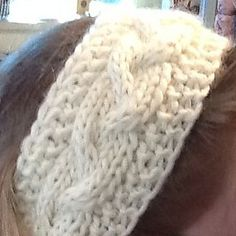 This soft, cabled headband will keep your ears warm on even the coldest winter days. The sequins in the mohair glitter like snowflakes on a starry night.