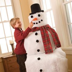 DIY- Frost-free the Snowman - It's no snow job -- this Frosty requires neither a white Christmas nor freezing temperatures to spread his cheer. All he needs is a stack of leftover boxes, a few pompoms, tape, felt, and some white quilt batting. Bonus: he comes apart, making him easy to store during the off-season.