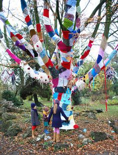 "well, knitting actually... ""wildbreien""... love it!  This tree makes me happy to look on it."