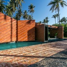 Coconut groves surround brick retirement home on a Thai beach by NPDA Studio