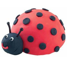 Line these little lady bugs on a platter and watch guests flit about. Turn Mini Ball Pan cakes into way-cute critters using Red Ice-A-Cookie and black licorice details.