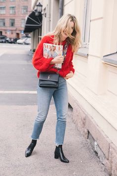 jeans, red sweater, black boots, blonde hair