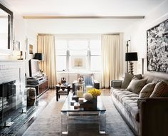 Living Room Photo - A seating arrangement with a Lucite-and-marble coffee table