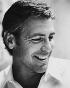 A black and white portrait of the man with a smile to die for - George Clooney. Shop for your wedding trousseau, with a personal shopper & stylist in India - Bridelan, visit our website www.bridelan.com #Bridelan