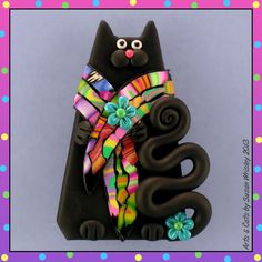 Black Kitty Cat Wearing a Colorful Scarf Pin