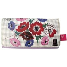 This gorgeous & Sew On Wallet Purse by Disaster Designs features beautiful printed floral designs with subtle sewing motifs including a thimble, needle & thread and pattern print