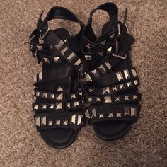 Penny loves Kenny studded gladiators Studded gladiators ,3 buckled straps on both sides of shoes studs threw out sandle worn a few times in good shape Penny loves kenny Shoes Sandals