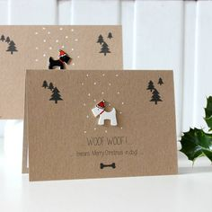 Did you know? 'Woof Woof!' means 'Merry Christmas' in dog! Say a very Merry Christmas to your friends and family with this Scottie dog Christmas card!The card can feature either a black or white Scottie Dog - choose which you'd prefer in the drop down menu.Handmade in Scotland using recycled card, this cool Christmas greetings card features a hand drawn plastic Scottie dog, all dressed up in his Santa hat! Inside is a fitted liner insert which has been left blank for you to write your own…