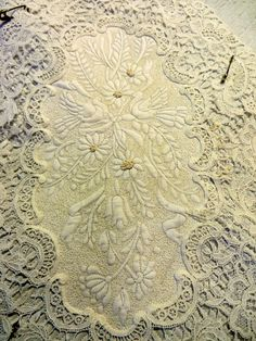 More beautifully detailed quilting on vintage linens by Cindy Needham.