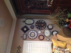 Clock wall - love all the different sizes and shapes