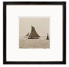This set of 8 framed Ben Wood prints feature some of England's most classic boats in action, shot from the sea and developed in a light sepia.  Product in photo is from www.wellappointedhouse.com