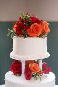wedding cake flowers red and orange #atlantaweddingflorist #atlantaflorist www.atlantaflowerbar.com Cake Flowers, Wedding Cakes With Flowers, Reception, Orange, Desserts, Red, Tailgate Desserts, Deserts, Postres