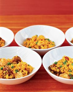 Easy Paella  Ingredients      2 tablespoons olive oil      3/4 pound medium shrimp, peeled and deveined      1 (12 ounces) chicken sausage, sliced in 1/2-inch rounds      1 medium onion, finely chopped      2 cloves garlic, minced      1 1/2 cups long-grain rice      1/4 teaspoon paprika      1/4 teaspoon ground turmeric      1 can (14.5 ounces) diced tomatoes      2 cans (14.5 ounces each) reduced-sodium chicken broth      Coarse salt and ground pepper      1 cup frozen green peas, thawed