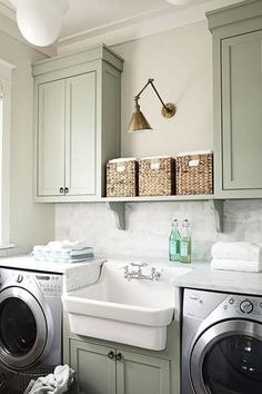 "Efficient Design - 10 Laundry Room Ideas We're Obsessed With - Southernliving. This ""room"" only takes up one wall, but has everything you could need in a laundry room: the machines, multiple work surfaces, a sink, and storage. Not to mention it's simply gorgeous with the green cabinetry and marble tiling.  See Pin"