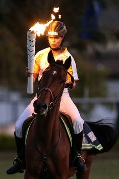 #RIO2016 Horsemounted militarized police sargent Elayne Silva carries the Olympic Torch during the torch relay on May 3 2016 in Brasilia Brazil The Olympic...