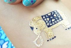 How adorable is this baby elephant tattoo from our Yoga Collection?TribeTats metallic tattoos are the highest quality flash tattoo brand, representing the intersection of jewelry, tattoos and body art. It is the only brand with perforated sheets, eliminating the need for scissors, and a proprietary remover to take off your tattoos whenever you would like.See More : http://www.tribetats.com/