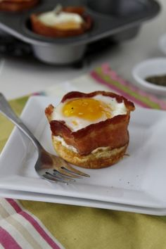 Preheat oven to 350 degrees.    2.  Spray muffin tin with non-stick cooking spray. Pour 2 teaspoons of pancake batter into each muffin well. Bake for approximately 4 minutes until set.    3. Increase temperature to 400 degrees. Wrap a piece of bacon around interior side of muffin tin. Crack egg into muffin tin. Season with salt and pepper. Continue with remaining cups. Bake for 10 minutes until whites have completely set and yolk is still runny.