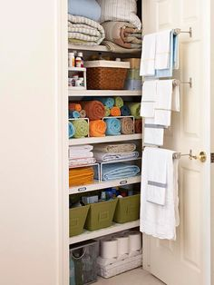linen closet organization. especially love the towel racks holding everyone's fresh towels so the family doesn't have to dig through (and mess up the organization) to get towels. great for guests, too.