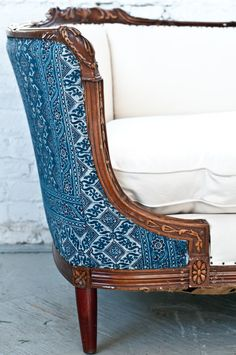 Vintage 1920's sofa we reupholstered in an indian batik print and crisp white.