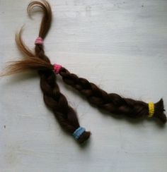 """Sophie's braids.....today I took this picture and put these in the jewelry box my mom gave me. Sophie says she wants her hair """"back on"""". She says it quite a bit. That makes me sad. So, I put these braids out of sight. They had been in plain view on a shelf in our bedroom since the day we cut them off. You wouldn't think a three year old could grasp vanity or what's pretty and what's not. I ask myself all the time who decided what is attractive and what isn't? I suppose that's where the…"""