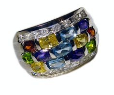 This stunning and colorful sterling silver, multi-color CZ band will  be a favorite in any wardrobe! This features 13 colored CZs and 16 Clear Accent CZs.**What is Rhodium Plating? Jewelers often use rhodium plating as a finish on silver, white gold and platinum jewelry. It gives the jewelry a brighter finish.  Rhodium plated jewelry is hypoallergenic so it won't turn your skin green. If you have yellow gold jewelry you can also have it rhodium plated for a new look.