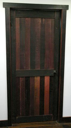 A door from old wine casks; perfect for the future wine room