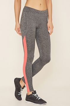 A pair of stretch knit athletic leggings with a colorblock panel down the side…