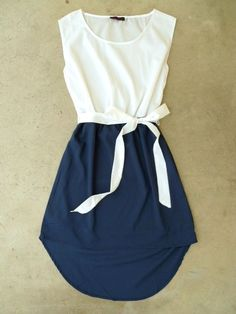 White and navy dress, bow.