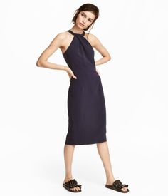 Dark blue. Fitted, knee-length dress in textured-weave fabric. Narrow-cut at top with a draped detail. Seam at waist and concealed zip and slit at back.