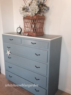 Old wooden cabinet dresser painted with custom mix of Annie Sloan chalk paint. Has a home in a little boy's room.