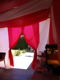 DIY Circus tent! I transformed my patio into a big top! I used rolls of red, and rolls of white, plastic table covers.