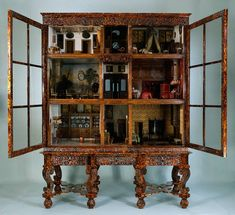 A 17th century Dutch dollhouse in a tortoiseshell cabinet. This was not for children to play with , but a very expensive hobby of Petronella Oortman. She had everythnig in it custom made by craftsmen and artists , real paintings, real china , it cost her a fortune 20.000-30.000 Guilders wich was as much as a real Amsterdam canalhouse at the time. AMAZING if you take a look at all the little treasures in it.
