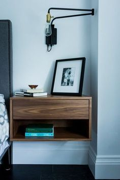 Design Dozen: 12 Clever Space-Saving Solutions for Small Bedrooms A nightstand that mounts on the wall is perfect for a small bedroom. The open space underneath the nightstand visually enlarges the space, and you can also stash things like shoes and bo Wood Nightstand, Floating Nightstand, Floating Shelves, Nightstand Ideas, Floating Drawer, Wall Mounted Bedside Table, Small Nightstand, Walnut Bedside Table, Floating Books