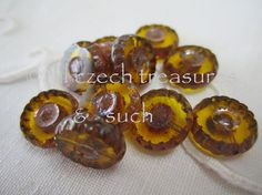 These are pretty gold or topaz Czech glass flower beads great for any project.