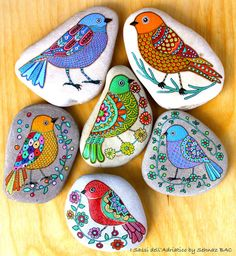 Hand Painted Stone Bird by ISassiDellAdriatico on Etsy...I love this artist's colorful birds!!