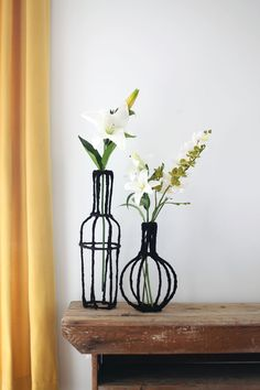 Turn some wire and scrap fabric into beautiful decorative vases for your home! Click through for instructions.