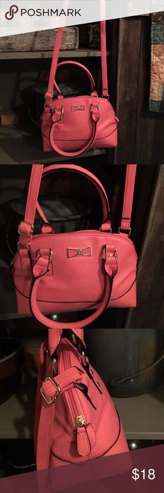 Pretty Pink Crossbody Handbag  Super cute!  New, without tags! This is so pretty pretty! A Crossbody & or handbag/shoulder bag! A very pretty pink this is unbranded & a faux leather like ~this is just so cute & nice! I just love the color & style! Trimmed w/gold hardware this has a pretty metal like bow design on the front, is a soft, comfy, 1 spacious inside area w/ a zippered pocket inside. This is more medium to small measuring approx. 12 in. Length by approx. 7 in. In height. Adjustable…