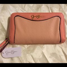Jessica Simpson ~ Lina Peach Wallet Jessica Simpson, Lina Wallet with multiple compartments and slots. It comes in a Melba (Coral) and Peach color. It is new with tags. Jessica Simpson Bags Wallets