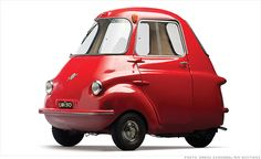 This Scootacar, a rather late model as microcars go, is from England. Like many microcars, it's essentially a three-wheeled scooter with an enclosed body. It's even steered using something that looks very much like handlebars. Only 1,500 were made and very few survive.