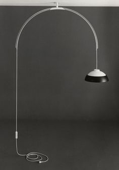 """Modello 2129"" was designed by Gino Sarfatti in 1969 and is an incredibly elegant arc-shaped droplight that can rotate 360 degrees. Remodelled by Flos 2013."