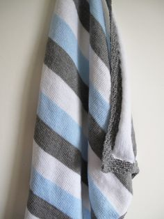 Grey, blue and white knitted baby blanket